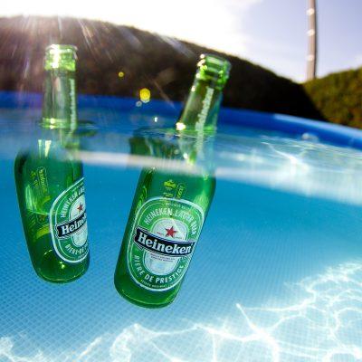 Heineken lager beer in pool